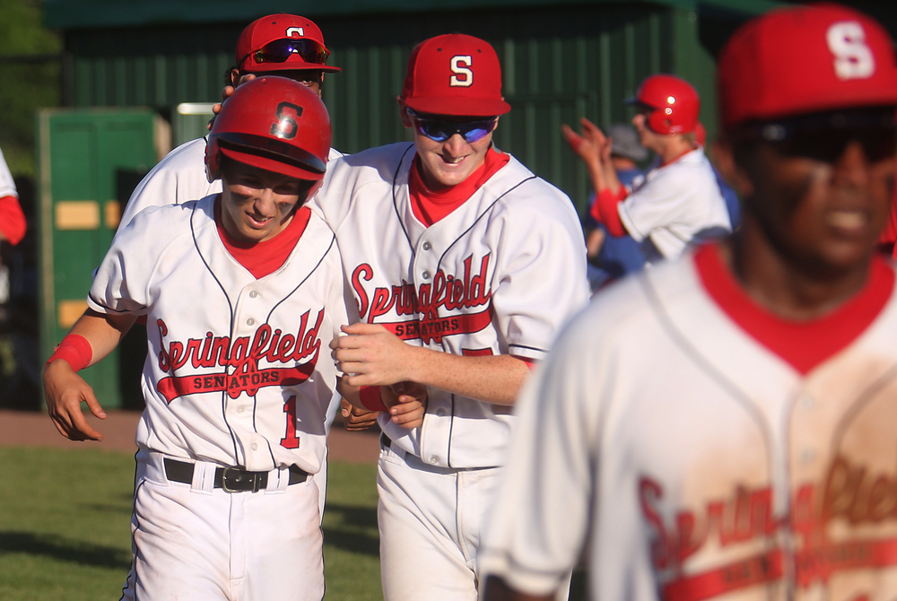 Springfield's Austin Kornack at left is embraced by teammate Luke Ketchum as they leave the field at the end of the game after Kornack took a fourth ball in the seventh inning on bases loaded for the Senators to win the game. David Spencer/The State Journal-Register