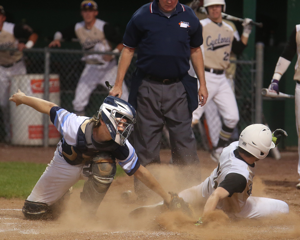 In fourth inning action, SHG baserunner Noah Crowe scores his team's second run of the night beyond the outstretched gloved of Champaign Centennial catcher Mike Namoff. David Spencer/The State Journal-Register