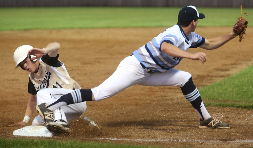 In fourth inning action, SHG stranded several on base, including Tommy Drake left, who was with the stretch of Champaign Centennial third baseman Dalton Webber. David Spencer/The State Journal-Register