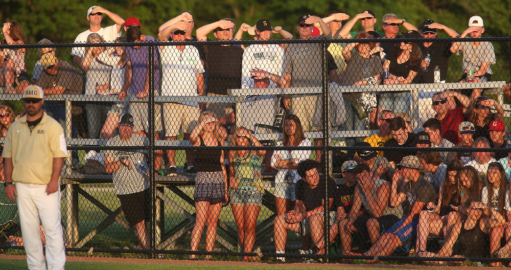 The early evening sun had SHG baseball fans shielding their eyes with their hands as they watch the game behind a fence along the first base line. David Spencer/The State Journal-Register