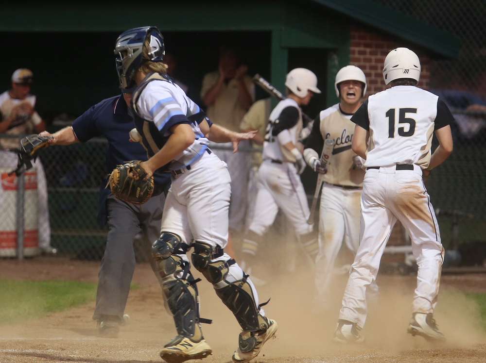 In fourth inning action, SHG baserunner Noah Crowe at right scores his team's second run of the night after Champaign Centennial catcher Mike Namoff was late with the tag. David Spencer/The State Journal-Register