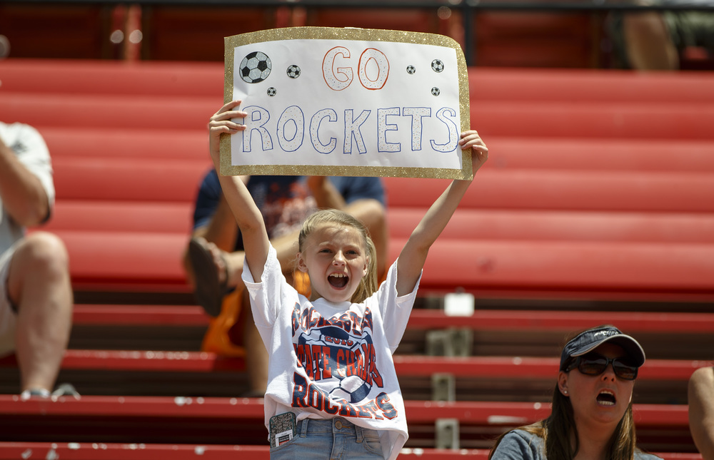 A young Rockets fan cheers on the team as they get set to take on Sycamore during the IHSA Class 2A Girls State Soccer Tournament semifinals at North Central College, Friday, June 3, 2016, in Naperville, Ill. Justin L. Fowler/The State Journal-Register