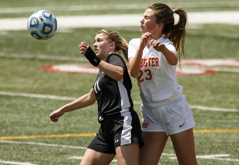 Sycamore's Taylor Meier (11) tries to keep the ball away from Rochester's Emma Hughes (23) in the first half during the IHSA Class 2A Girls State Soccer Tournament semifinals at North Central College, Friday, June 3, 2016, in Naperville, Ill. Justin L. Fowler/The State Journal-Register