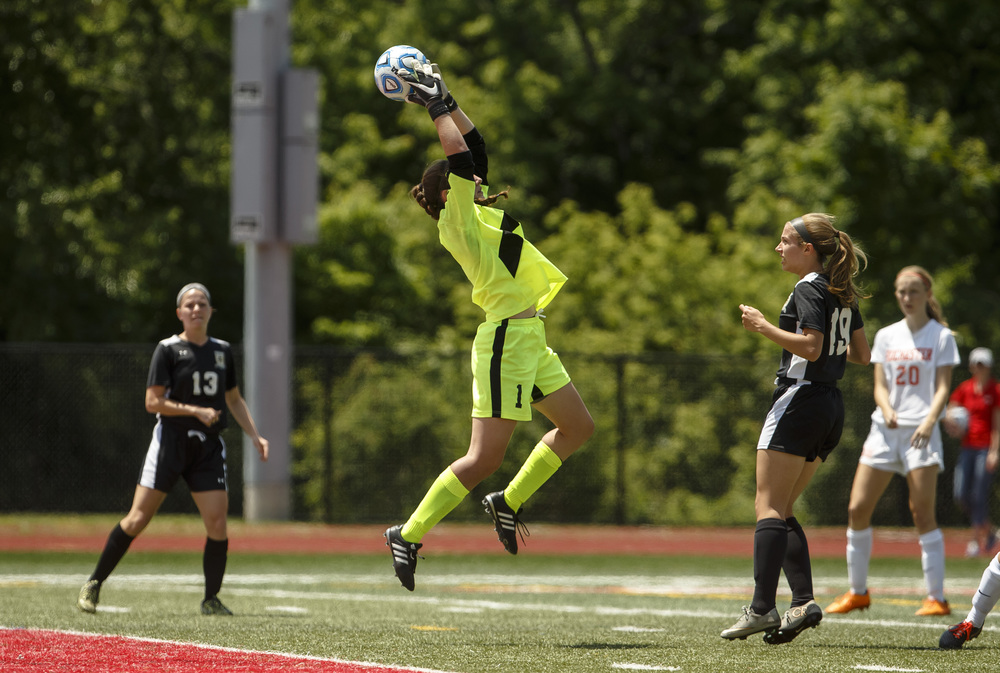 Sycamore goal keeper Amanda Cook (1) grabs a save in her fingertips in front of the goal against Rochester in the first half during the IHSA Class 2A Girls State Soccer Tournament semifinals at North Central College, Friday, June 3, 2016, in Naperville, Ill. Justin L. Fowler/The State Journal-Register