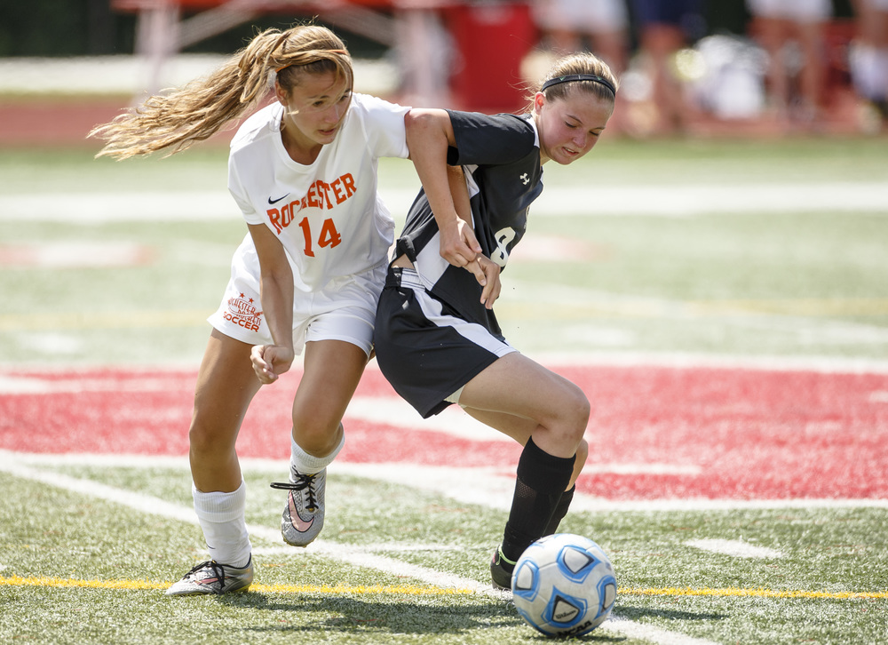 Rochester's Riley Ross (14) gets tangled up with Sycamore's Carly Kresge (9) as they both go for possession in the second half during the IHSA Class 2A Girls State Soccer Tournament semifinals at North Central College, Friday, June 3, 2016, in Naperville, Ill. Justin L. Fowler/The State Journal-Register
