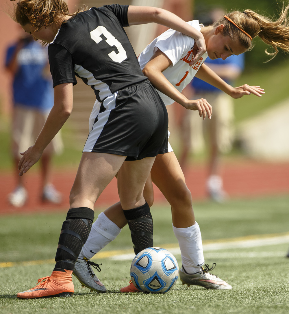 Sycamore's Jenna Lewey (3) and Rochester's Aspen Thomas (1) battle at their feet for the ball in the second half during the IHSA Class 2A Girls State Soccer Tournament semifinals at North Central College, Friday, June 3, 2016, in Naperville, Ill. Justin L. Fowler/The State Journal-Register