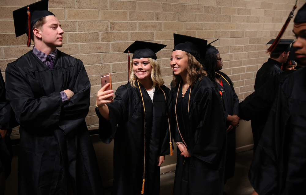 Soon-to-be Lanphier graduates Haylie Darland at left takes a selfie photo with Haley Fitzgerald before they processed Saturday morning. David Spencer/The State Journal- Register