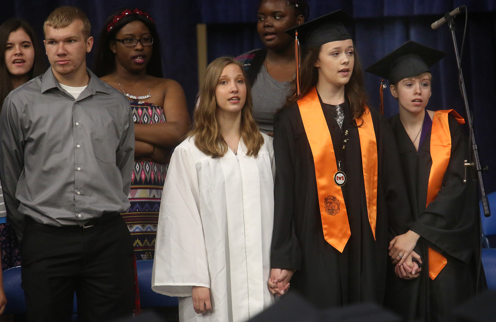 "Three members of the Lanphier High School choir clasped hands while singing ""And Wherever You Go"" Saturday morning. David Spencer/The State Journal- Register"
