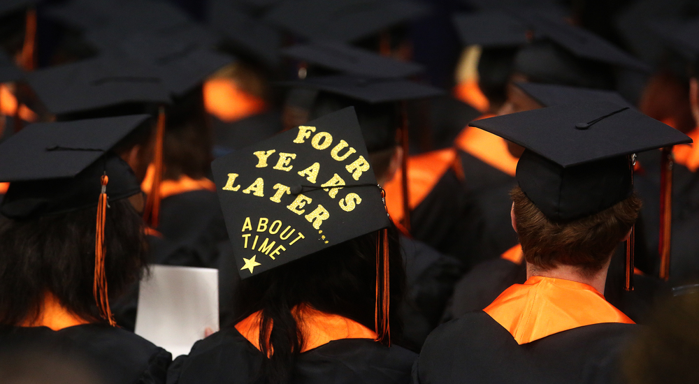 The sentiment of one soon-to-be Lanphier graduate was done in gold glitter atop her mortarboard Saturday morning. David Spencer/The State Journal- Register