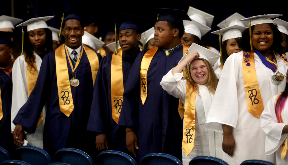 After processing, soon-to-be Southeast graduates turned to watch their fellow students also process. David Spencer/The State Journal- Register