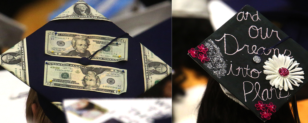 Dreams at right and cold hard cash at left were just two theme reflected atop Southeast student mortarboards Saturday. David Spencer/The State Journal- Register