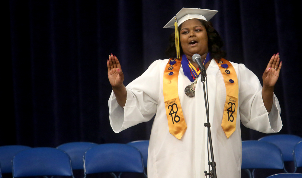 "Southeast graduate Calia Cole brought down the house with her singing of ""I will Always Love You"" by Whitney Houston. David Spencer/The State Journal- Register"