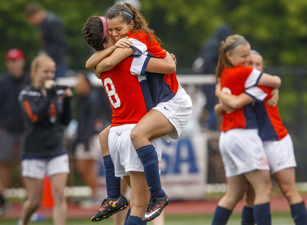 Rochester's Becca Jostes leapt into Amanda Williams arms after the Rockets defeated Deerfield 4-0 during the girls Class 2A Soccer State Championship at at North Central College in Naperville, Ill., Saturday, June 4, 2016. Ted Schurter/The State Journal-Register