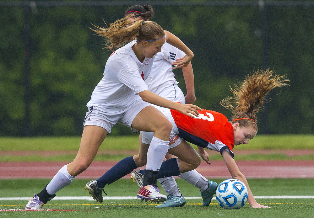 Rochester's Katie Cochran is tripped up by Deerfield defenders during the girls Class 2A Soccer State Championship at at North Central College in Naperville, Ill., Saturday, June 4, 2016. Ted Schurter/The State Journal-Register