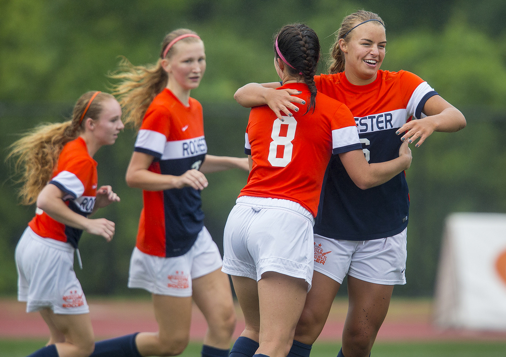 Rochester's Meagan McNicholas hugs Amanda Williams after she scored against Deerfield during the girls Class 2A Soccer State Championship at at North Central College in Naperville, Ill., Saturday, June 4, 2016. Ted Schurter/The State Journal-Register