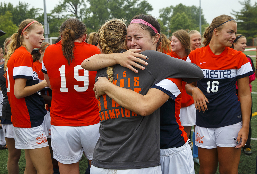 Rochester's Amanda Williams hugs goal keeper Maddie Gleeson as the Rockets celebrate their win against Deerfield during the girls Class 2A Soccer State Championship at at North Central College in Naperville, Ill., Saturday, June 4, 2016. Ted Schurter/The State Journal-Register