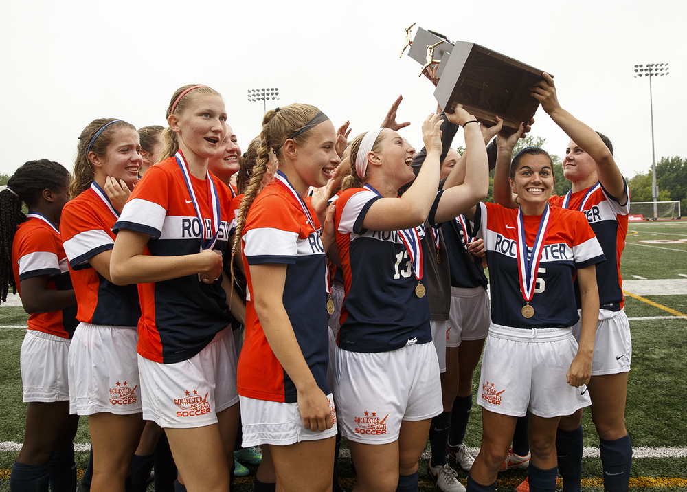 The Rochester Rockets hoist their championship trophy after defeating Deerfield during the girls Class 2A Soccer State Championship at at North Central College in Naperville, Ill., Saturday, June 4, 2016. Ted Schurter/The State Journal-Register