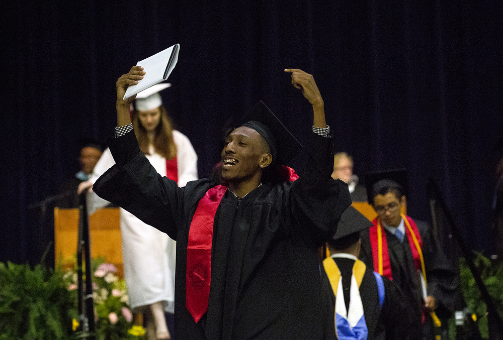 Darion Jones responds to cheers from family at the Springfield High School graduation Saturday, June 4, 2016 at the Prairie Capital Convention Center. Rich Saal/The State Journal-Register
