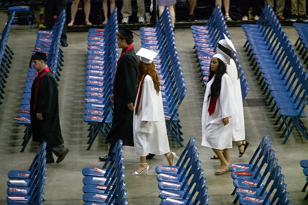 Seniors process into the Prairie Capital Convention Center  for Springfield High School's graduation Saturday, June 4, 2016. Rich Saal/The State Journal-Register
