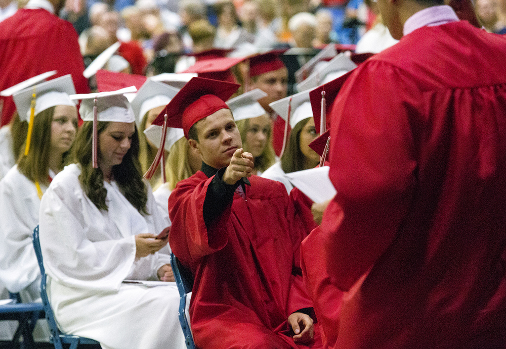 Tyler Dowell acknowledges one of his friends at the Glenwood High School graduation Saturday, June 4, 2016 at the Prairie Capital Convention Center. Rich Saal/The State Journal-Register