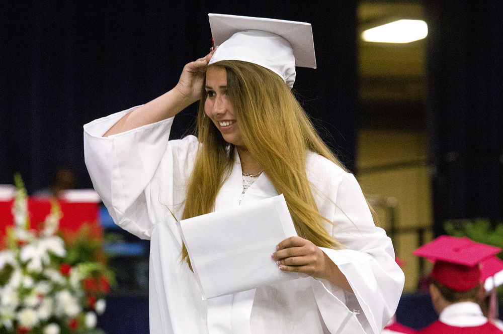 Morgan Steiner adjusts her cap after leaving the stage with her diploma at Glenwood High School's graduation Saturday, June 4, 2016 at the Prairie Capital Convention Center. Rich Saal/The State Journal-Register