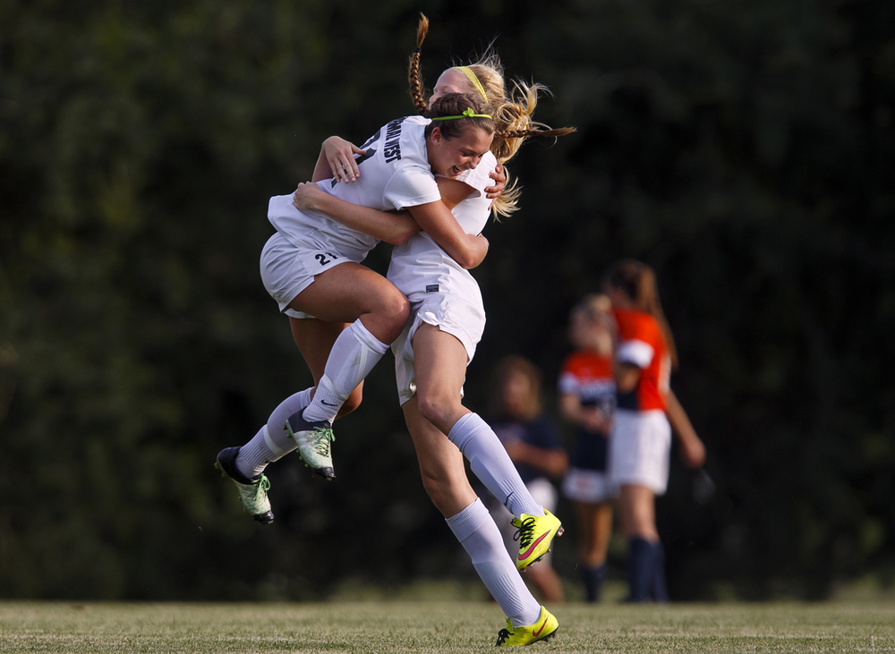 Normal West's Allison Mitchell leaps intoteammate Jess Hieb's arms after the Wildcats scored against Rochester during the Class 2A Springfield Supersectional soccer at the University of Illinois Springfield Monday, May 31, 2016. Ted Schurter/The State Journal-Register