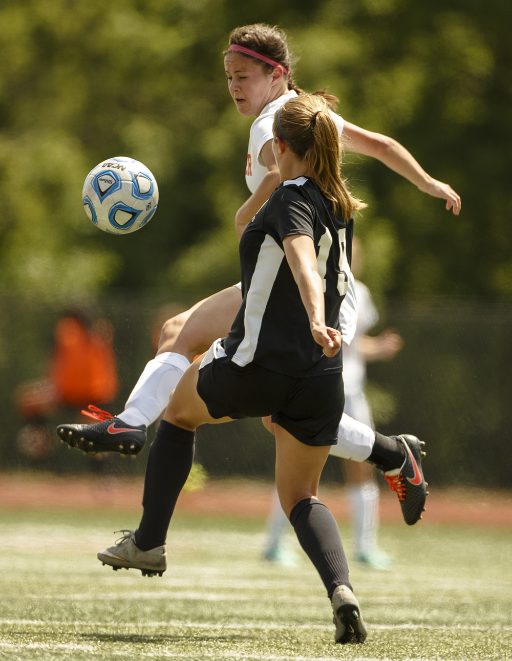 Rochester's Amanda Williams (8) sends the ball back over midfield out of the air against Sycamore's Anna Haub (19) in the second half during the IHSA Class 2A Girls State Soccer Tournament semifinals at North Central College, Friday, June 3, 2016, in Naperville, Ill. Justin L. Fowler/The State Journal-Register