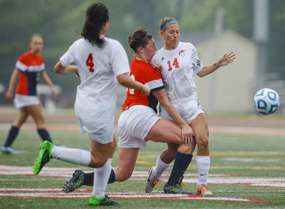 Rochester's Maddie Capps collides with a Deerfield defender during the girls Class 2A Soccer State Championship at at North Central College in Naperville, Ill., Saturday, June 4, 2016. Ted Schurter/The State Journal-Register