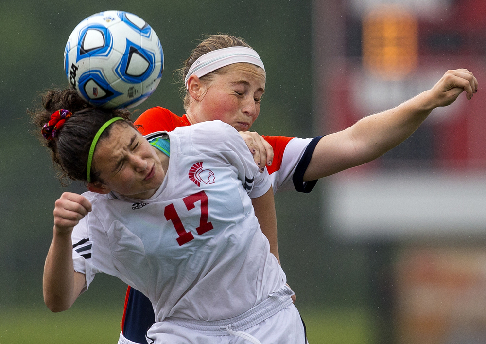 Deerfield's Enya Horgan heads the ball in front of Rochester's Baylee Smith during the girls Class 2A Soccer State Championship at at North Central College in Naperville, Ill., Saturday, June 4, 2016. Ted Schurter/The State Journal-Register