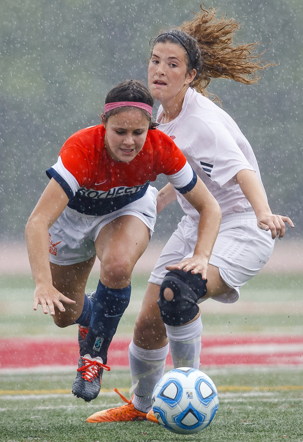 Rochester's Amanda Williams is tripped up by a Deerfield defender during the girls Class 2A Soccer State Championship at at North Central College in Naperville, Ill., Saturday, June 4, 2016. Ted Schurter/The State Journal-Register