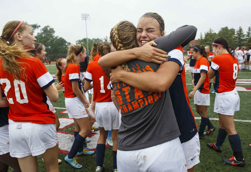Rochester's Meagan McNicholas hugs her teammates after the Rockets defeated Deerfield during the girls Class 2A Soccer State Championship at at North Central College in Naperville, Ill., Saturday, June 4, 2016. Ted Schurter/The State Journal-Register