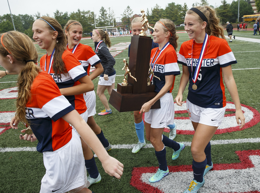 Rochester's Mady Schmidt laughs with her teammates as she carries the trophy after the Rockets defeated Deerfield during the girls Class 2A Soccer State Championship at at North Central College in Naperville, Ill., Saturday, June 4, 2016. Ted Schurter/The State Journal-Register