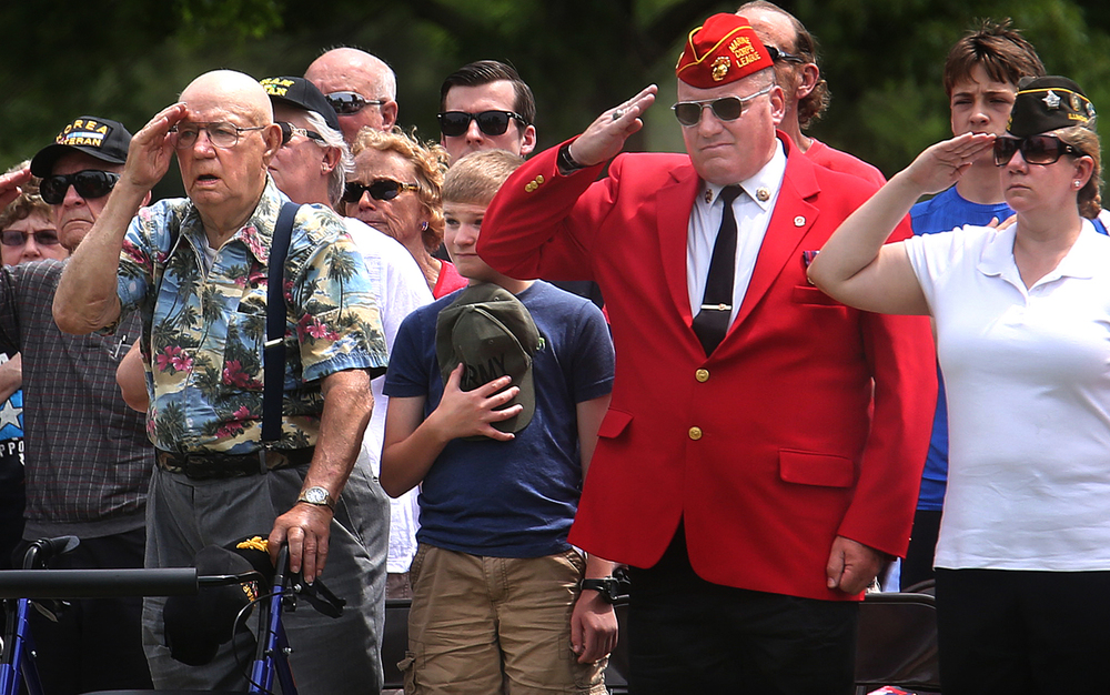 During the Pledge of Allegiance, veterans and others attending the ceremony saluted and placed hands over their hearts. WWII veteran Vince Speranza of Auburn, who served in the 101st Airborne Division, was the keynote speaker at the annual Memorial Day Ceremony held at Camp Butler National Cemetery in Springfield on Monday afternoon, May 30, 2016. David Spencer/The State Journal-Register