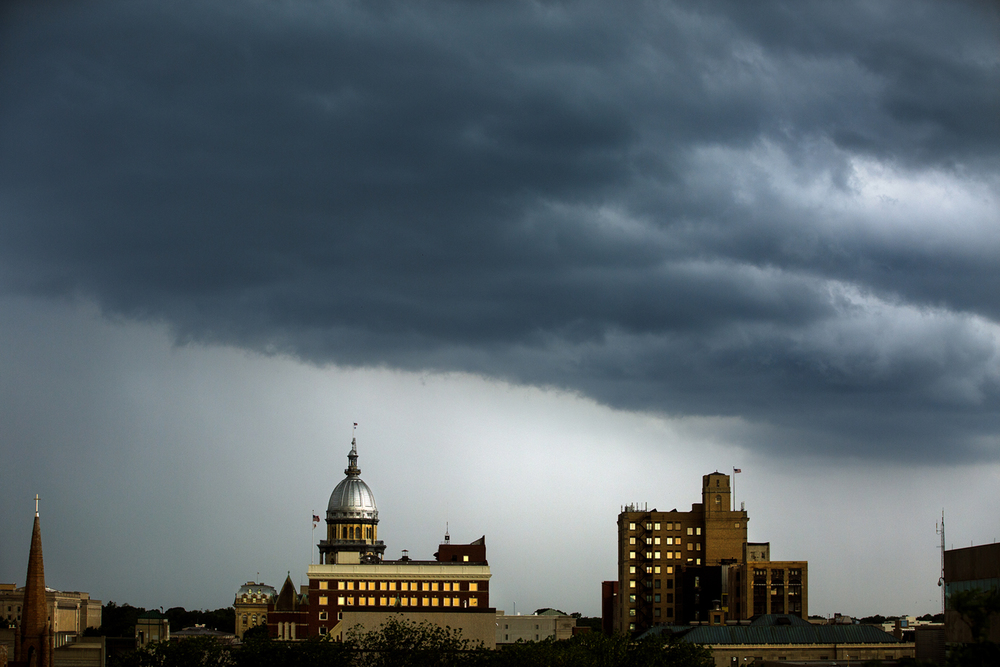 Thunderstorms move into downtown Springfield Tuesday, May 31, 2016, dropping a heavy but brief shower. Thunderstorms are 60 percent likely again today, (Wednesday) according to the National Weather Service. Rich Saal/The State Journal-Register