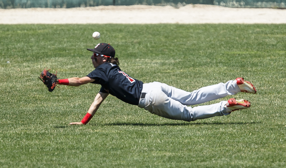 Springfield's Austin Kornack (1) dives trying to catch a line drive from Bartonville Limestone in the third inning during the IHSA Class 3A State Tournament semifinals at Silver Cross Field, Friday, June 10, 2016, in Joliet, Ill. Justin L. Fowler/The State Journal-Register