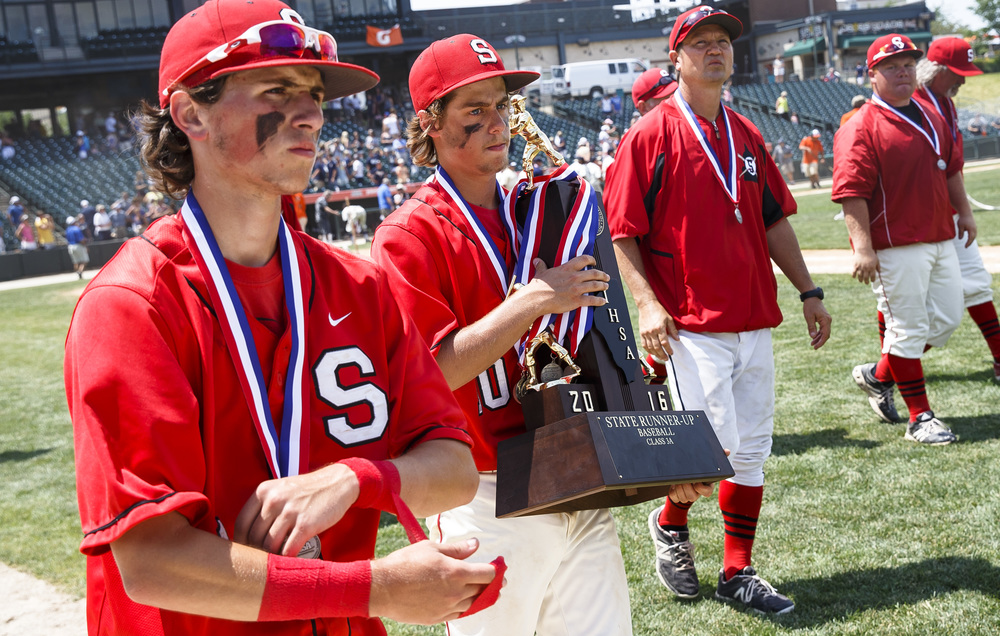 Springfield's Jake Langellier (10) carries the second place trophy off the field along with Springfield's Austin Kornack (1) after the Senators were defeated 10-0 by Lemont in the IHSA Class 3A State Tournament Championship at Silver Cross Field, Saturday, June 11, 2016, in Joliet, Ill. Justin L. Fowler/The State Journal-Register