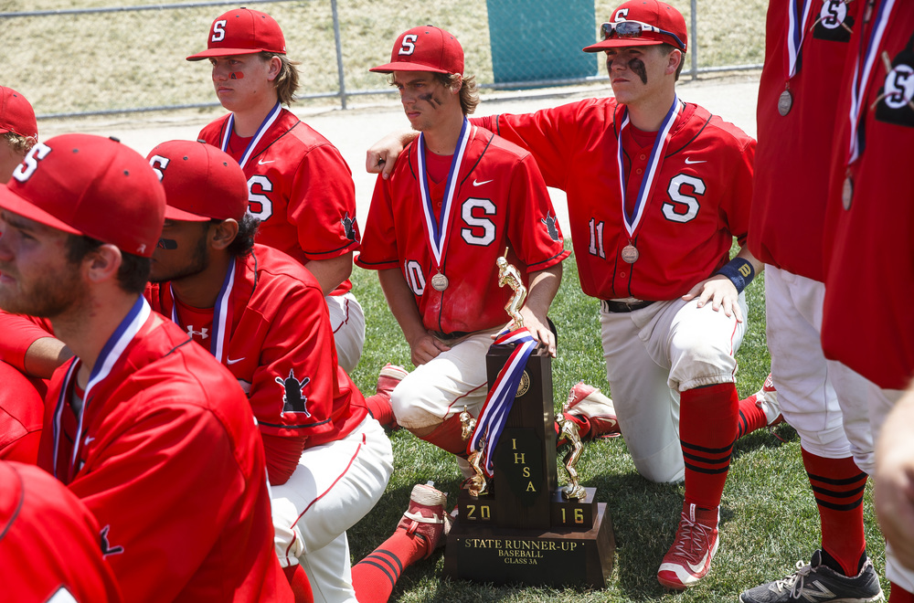 Springfield's Tanner Bleigh (11) and and Springfield's Jake Langellier (10) look after the second place trophy as they listen to Springfield baseball head coach Jim Steinwart after the Senators 10-0 defeat to Lemont in the IHSA Class 3A State Tournament Championship at Silver Cross Field, Saturday, June 11, 2016, in Joliet, Ill. Justin L. Fowler/The State Journal-Register