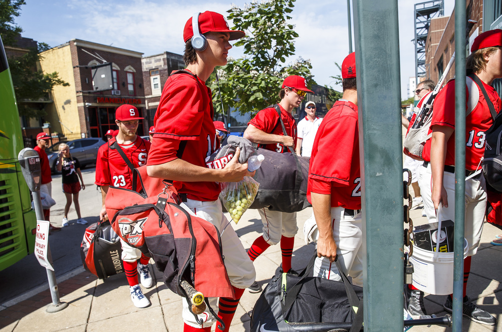Springfield's Ethan Klay (14) and the Senators make their way into the Stadium as they unload from the bus for the IHSA Class 3A State Tournament Championship at Silver Cross Field, Saturday, June 11, 2016, in Joliet, Ill. Justin L. Fowler/The State Journal-Register