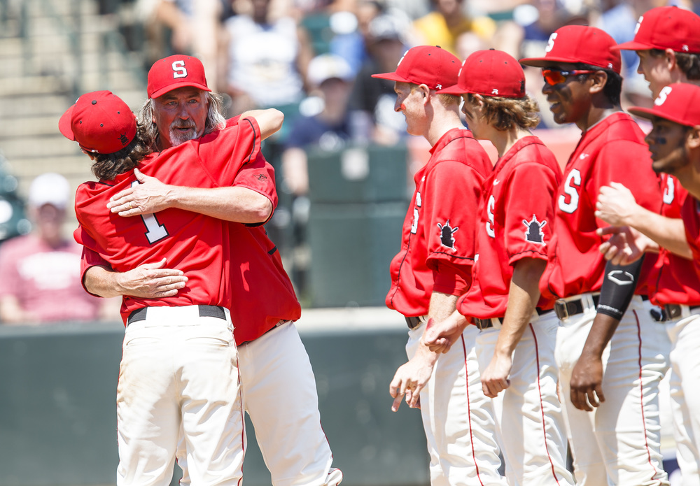 Springfield baseball head coach Jim Steinwart gets a hug from Springfield's Austin Kornack (1) during player introductions as the Senators get set to take on Lemont in the IHSA Class 3A State Tournament Championship at Silver Cross Field, Saturday, June 11, 2016, in Joliet, Ill. Justin L. Fowler/The State Journal-Register