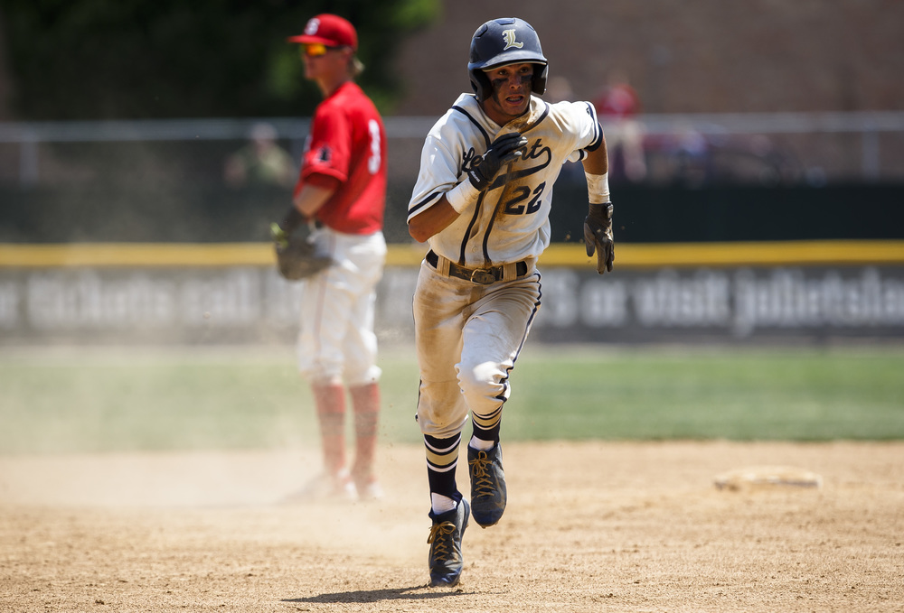 Lemont's Christian Krakar (22) heads to third base off an error from Springfield trying to pick him off at second base in the third inning during the IHSA Class 3A State Tournament Championship at Silver Cross Field, Saturday, June 11, 2016, in Joliet, Ill. Justin L. Fowler/The State Journal-Register