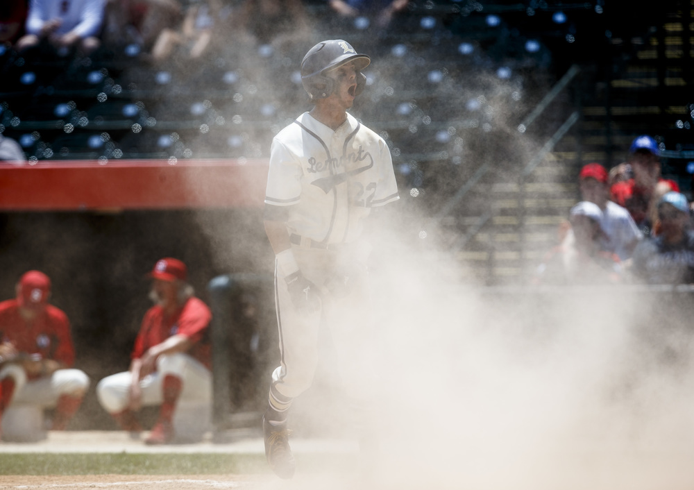 Lemont's Christian Krakar (22) is fired up after scoring a run to make it 1-0 Lemont against Springfield in the third inning during the IHSA Class 3A State Tournament Championship at Silver Cross Field, Saturday, June 11, 2016, in Joliet, Ill. Justin L. Fowler/The State Journal-Register