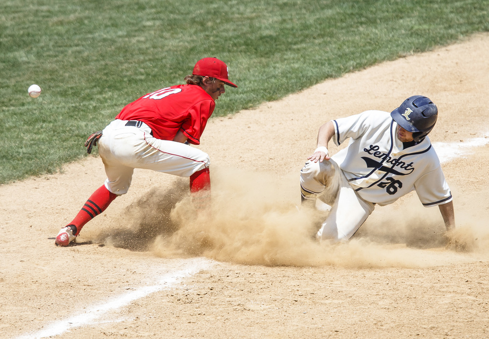 Lemont's Jake Leibfritz (26) is safe at third as the throw bounces off the glove of Springfield's Jake Langellier (10) in the fifth inning during the IHSA Class 3A State Tournament Championship at Silver Cross Field, Saturday, June 11, 2016, in Joliet, Ill. Justin L. Fowler/The State Journal-Register