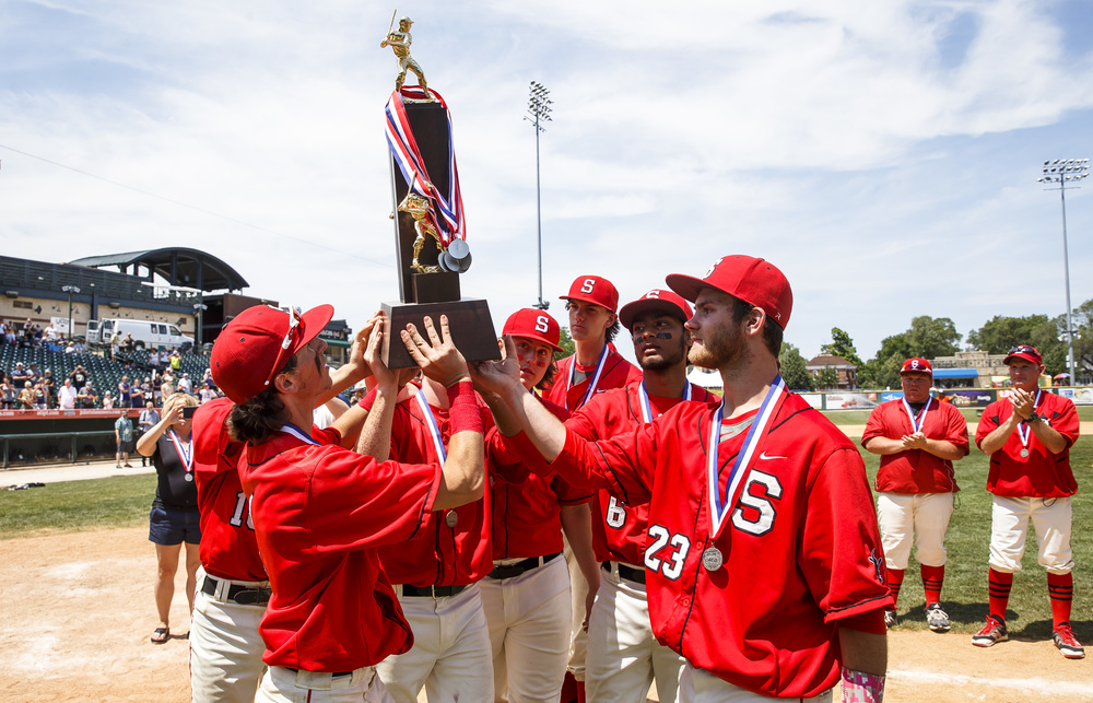 Springfield's Austin Kornack (1) and Springfield's Michael Lavin (23) and their teammates hoist up the second-place trophy after the Senators were defeated 10-0 by Lemont in the IHSA Class 3A State Tournament Championship at Silver Cross Field, Saturday, June 11, 2016, in Joliet, Ill. Justin L. Fowler/The State Journal-Register
