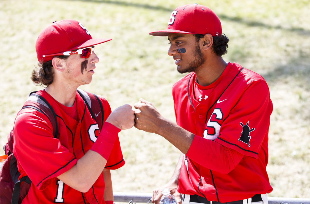 Springfield's Austin Kornack (1) and Springfield's Vishakh Patel (6) get a pre-game fist bump prior to the Senators taking on Lemont in the IHSA Class 3A State Tournament Championship at Silver Cross Field, Saturday, June 11, 2016, in Joliet, Ill. Justin L. Fowler/The State Journal-Register