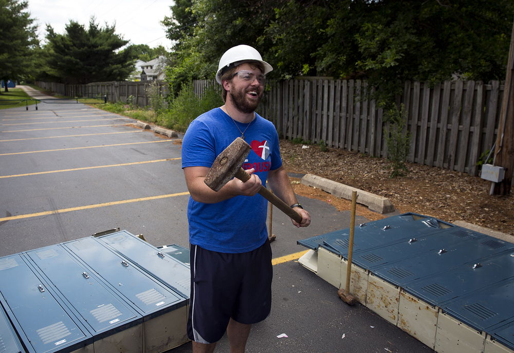 "Jacob Koch gets ready to take a swing at lockers from the old temporary buildings on the Lutheran High School campus Saturday, June 11, 2016. The ""smash a locker"" event was part of the demolition party to celebrate the end of the well-used quad campus. Rich Saal/The State Journal-Register"