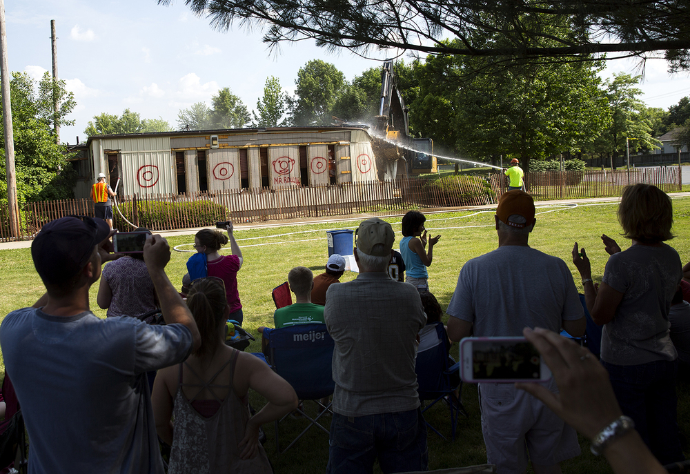 A crowd of Lutheran High School families watch the demolition of the 30-year-old quad campus at Lutheran High School Saturday, June 11, 2016. Rich Saal/The State Journal-Register
