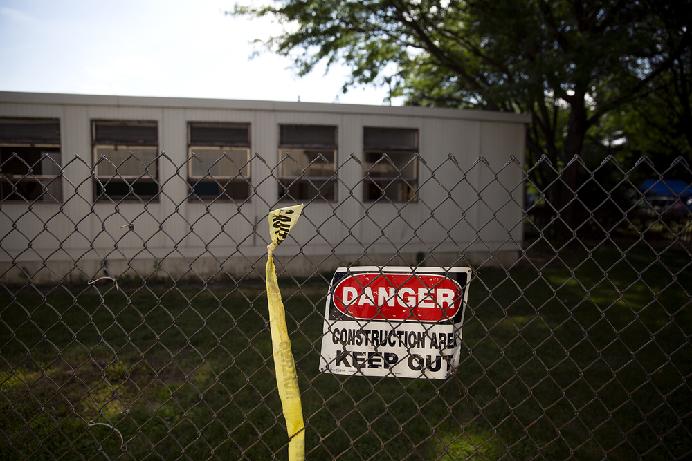 The old temporary classrooms on the Lutheran High School campus are being demolished to make way for a new addition to the high school. Construction on the addition will begin this fall. Rich Saal/The State Journal-Register