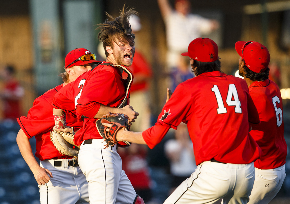 Springfield's Michael Lavin (23) leaps up to celebrate with Springfield's Ethan Klay (14) after the Senators defeated Freeburg 10-5 during the IHSA Class 3A Sauget Supersectional at GCS Ballpark, Monday, June 6, 2016, in Sauget, Ill. Justin L. Fowler/The State Journal-Register