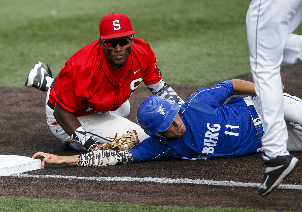 Freeburg's Braeden Chandler (11) clings to the bag as Springfield's Damian Pierce (12) tries to tag him out in the second inning during the IHSA Class 3A Sauget Supersectional at GCS Ballpark, Monday, June 6, 2016, in Sauget, Ill. Justin L. Fowler/The State Journal-Register