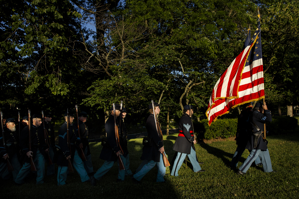 Jim Leinicke carries the US flag as he leads members of the 114th Regiment Volunteers Reactivated as they march toward the crowd gathered at Lincoln's Tomb for the first of the weekly summer flag-lowering ceremonies at the Lincoln Tomb Tuesday, June 7, 2016. Ted Schurter/The State Journal-Register